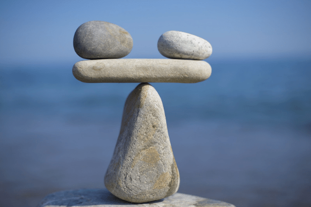 Balancing rocks representing the pros and cons of using an iPaaS