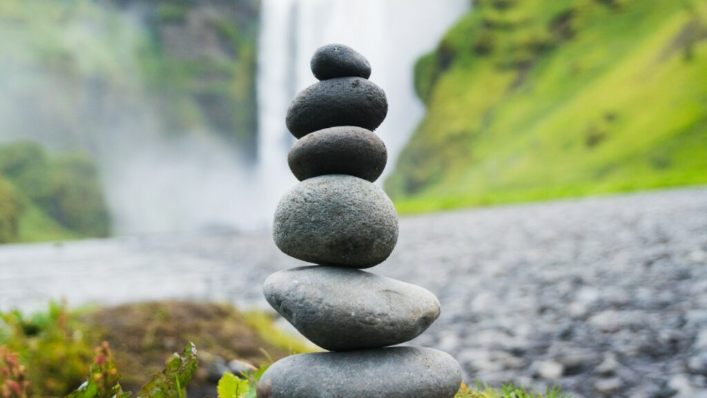 Rocks Ascending from Large to Small representing Monolithic vs Microservices architectures