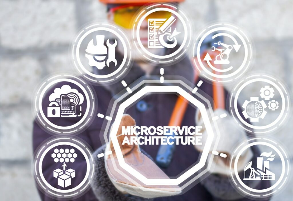 Man in hardhat presents diagram of microservices architecture