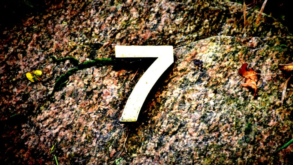 The number seven on gravel representing seven recent API trends.