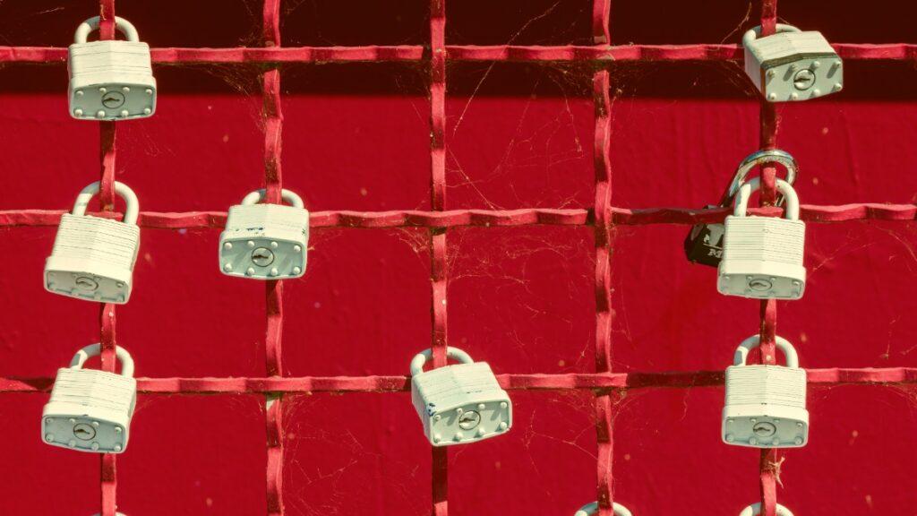 Locks on red wall securing API keys