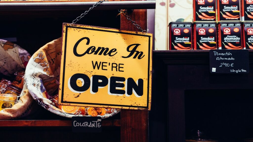Small business displaying open sign