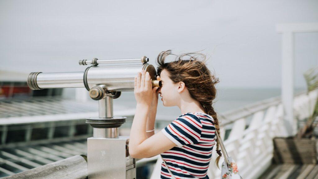 Woman looking through binoculars to achieve API discoverability