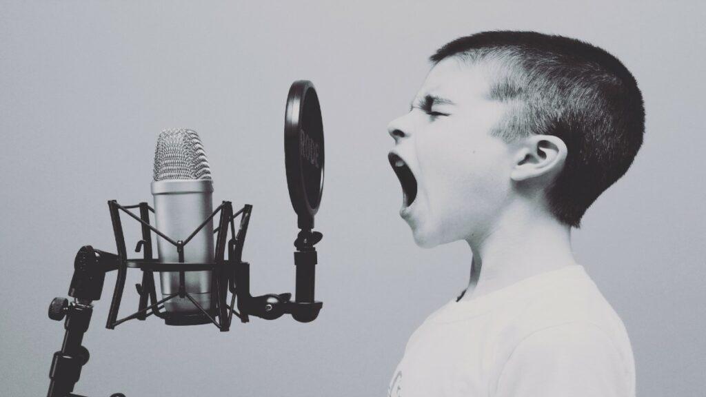 Boy talking into microphone as an evangelist for digital transformation