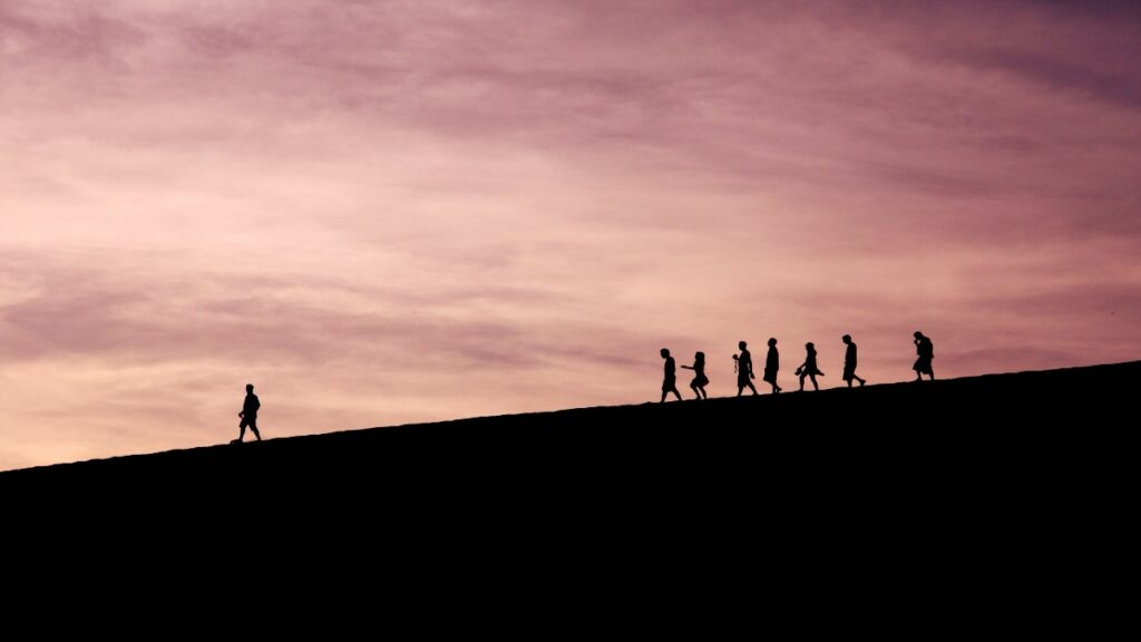 People walking on a hill being led by an API strategy