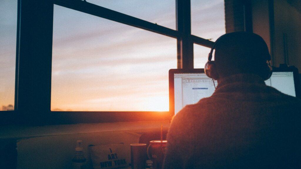 Man at computer structuring digital transformation